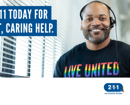 helpful smiling operator looking at camera and text encoraging calls to 211
